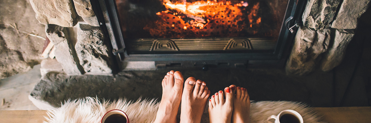 man and woman sitting on run in front of GCD fireplace