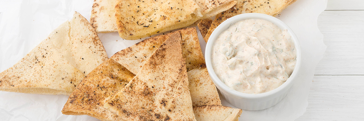 warm pita bread and tziki dip
